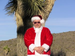 Richard Lowe as Santa Claus in the desert